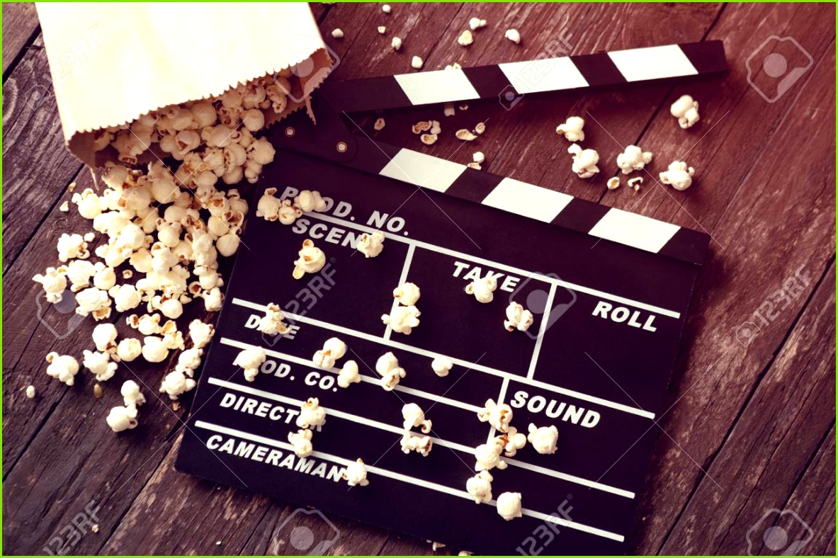 movie clapper board with fresh popcorn Stock