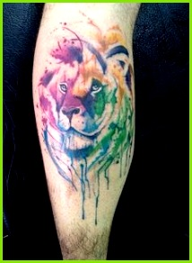 Lion watercolor tattoo on leg calf Leo Tattoos Feather Tattoos Tattoos Motive Tattoos
