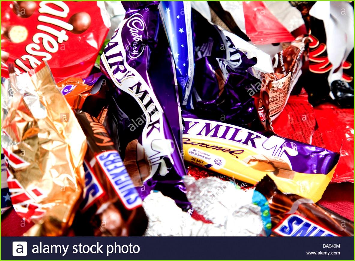 Verschiedene Süßigkeiten und Schokoriegel Wrapper Stockbild